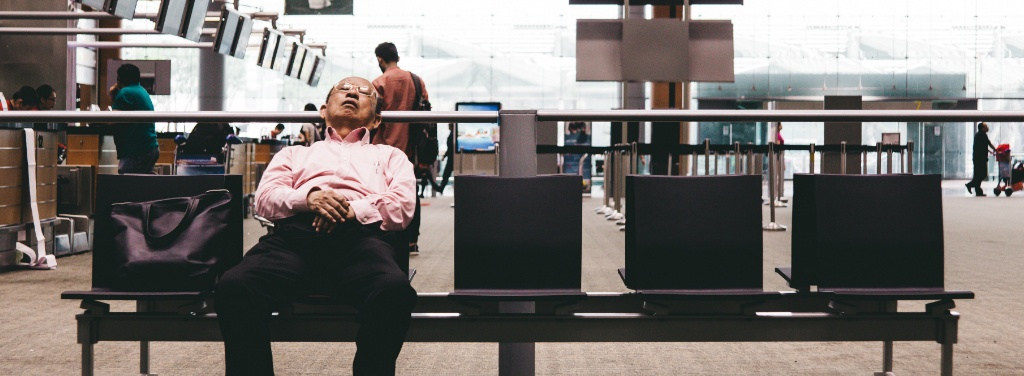 man sleeping at airport