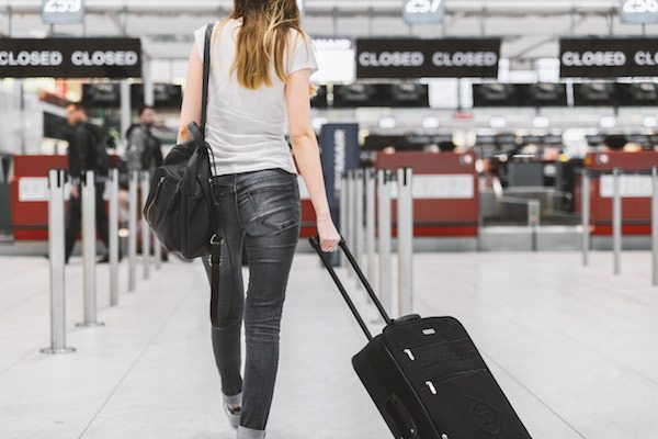 woman by closed check-in desks