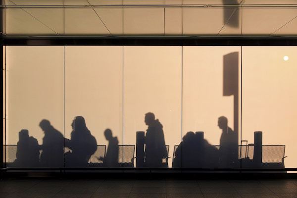 passengers wait in an airport