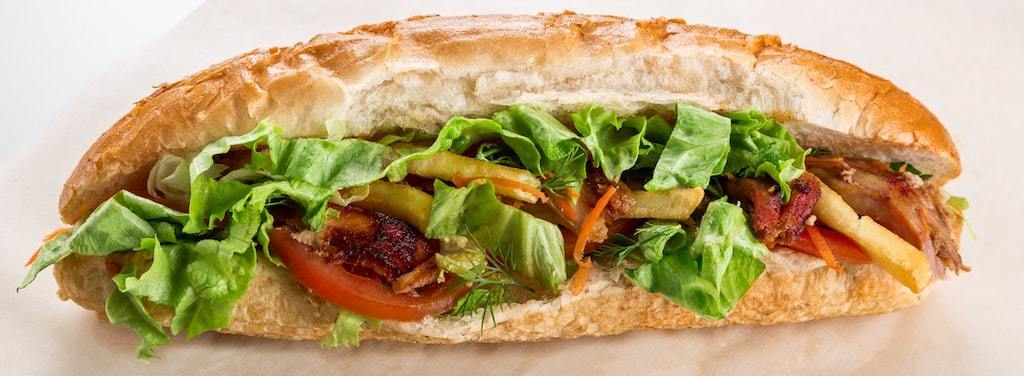 Packed beef sandwich with lettuce and tomatoes