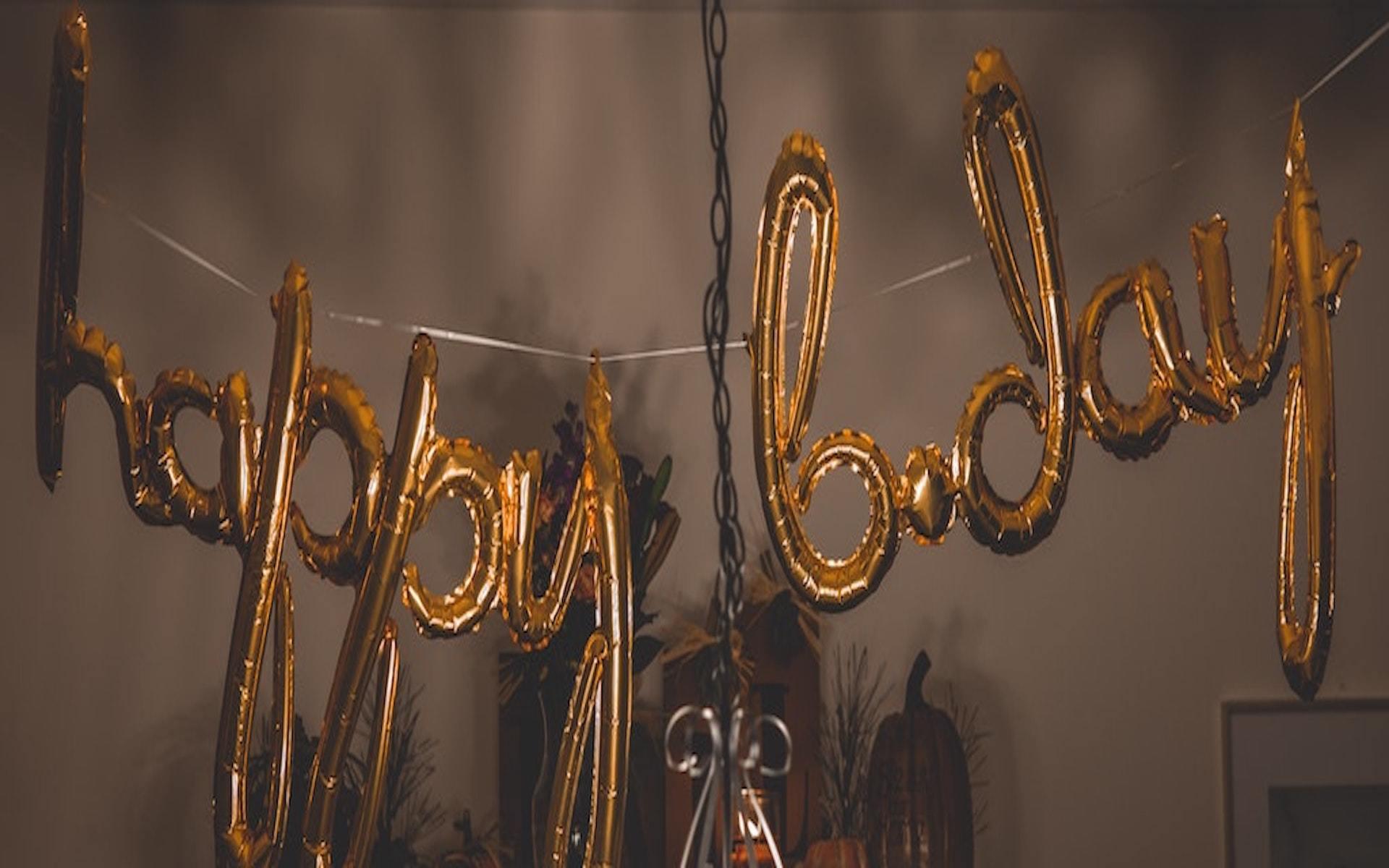 gold happy bday balloons
