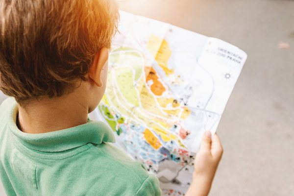 small child looking at a map