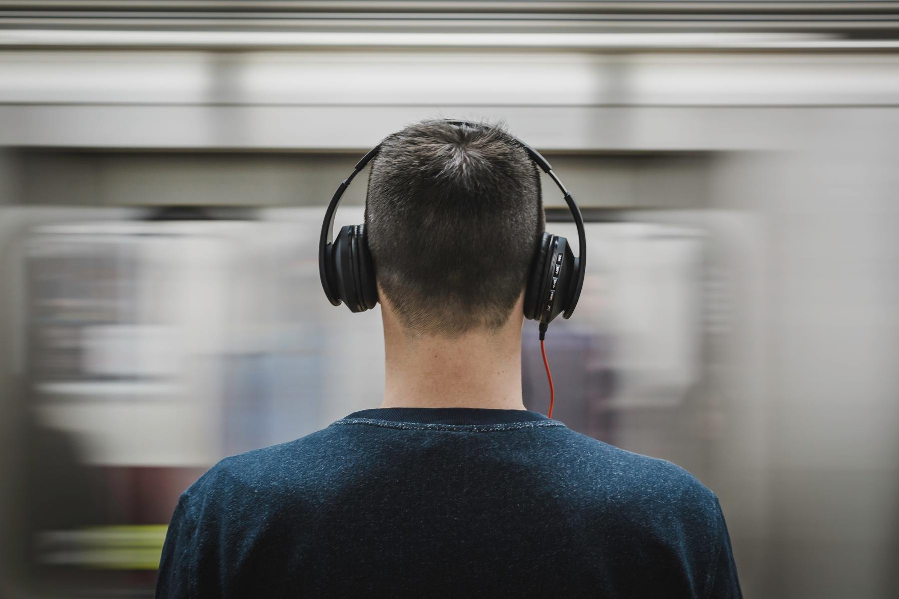 Man with headphones from the back