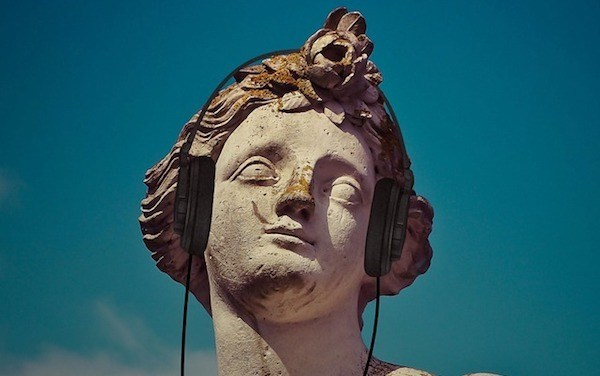 statue wearing a headset