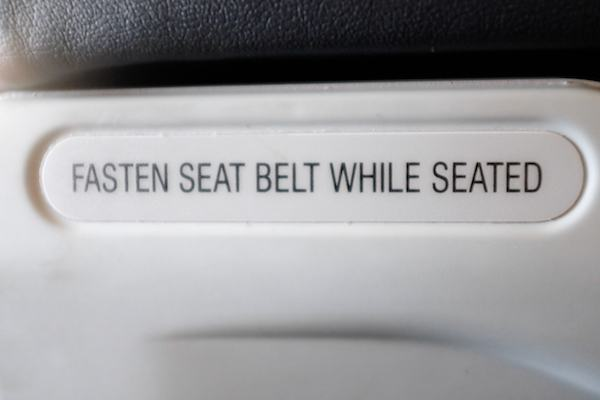 fasten seat belt while seated sign