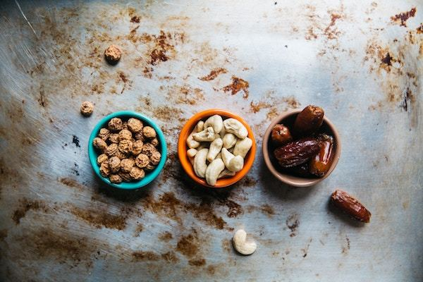 bowls of nuts and dried fruits
