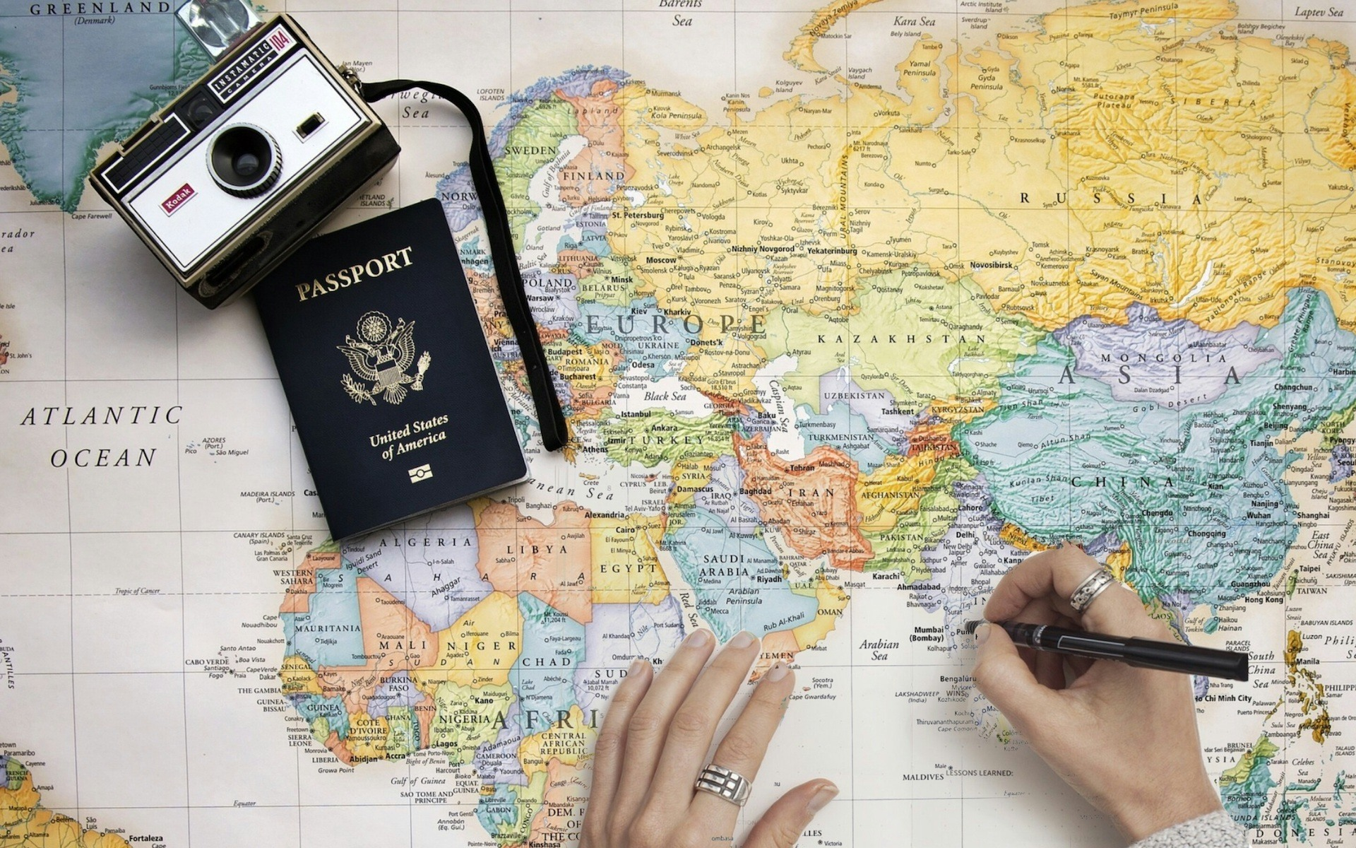 passport about to expire and camera over world map