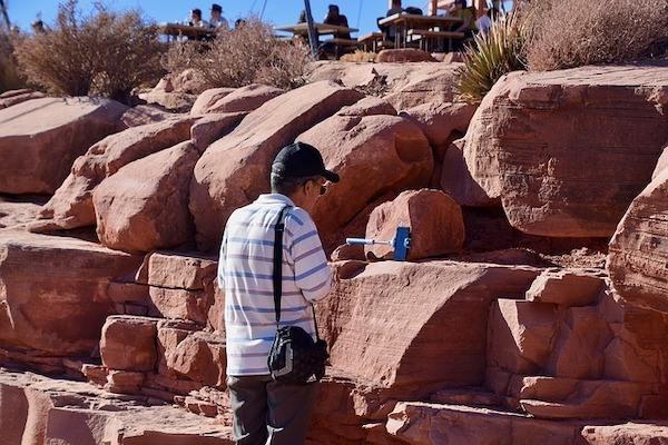 Selfie by red rocks with selfie stick