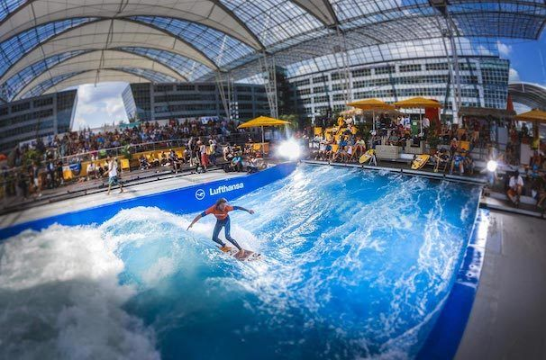 surfer on indoor wave at Munich International Airport